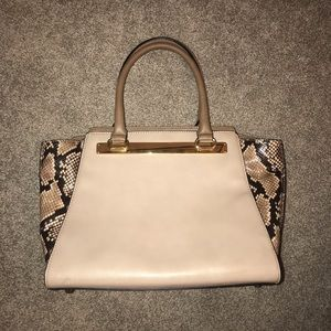 Tan and snakeskin purse